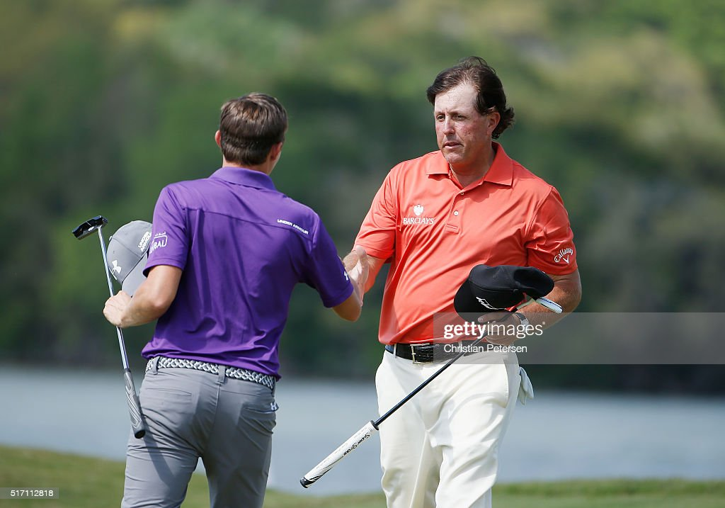 Phil Mickelson of the United States (R) shakes hands with Matthew Fitzpatrick of England on the 14th green after Mickelson won their match 5&4 during the first round of the World Golf Championships-Dell Match Play at the Austin Country Club on March 23, 2016 in Austin, Texas.