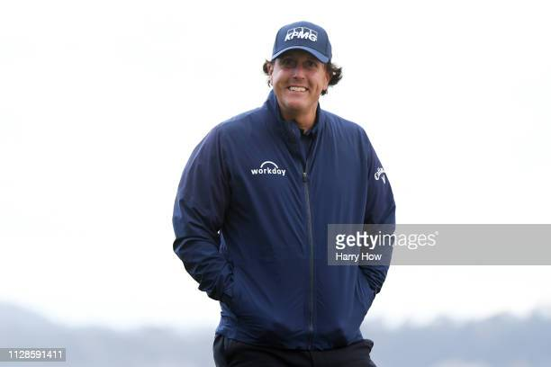 Phil Mickelson of the United States smiles during the third round of the ATT Pebble Beach ProAm at Pebble Beach Golf Links on February 09 2019 in...