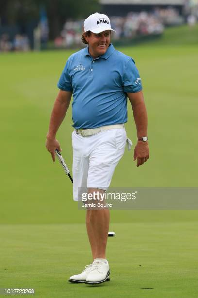 Phil Mickelson of the United States smiles on the first green during a practice round prior to the 2018 PGA Championship at Bellerive Country Club on...