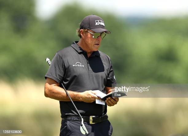 Phil Mickelson of the United States stands on the fourth green during the final round of the Travelers Championship at TPC River Highlands on June 28...