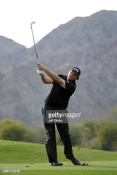 Phil Mickelson of the United States takes his second shot on the 14th fairway during the final round of the Desert Classic at the Stadium Course on...