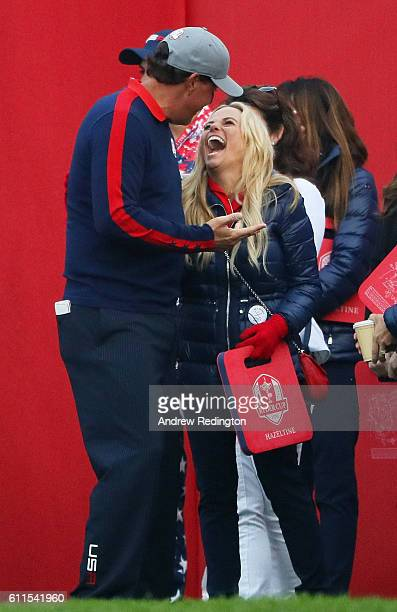 Phil Mickelson of the United States talks to wife Amy Mickelson on the first tee during morning foursome matches of the 2016 Ryder Cup at Hazeltine...