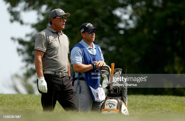 Phil Mickelson of the United States talks with his caddie and brother Tim Mickelson during the first round of the Workday Charity Open on July 09...