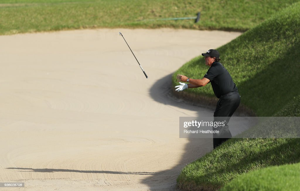 Phil Mickelson of the United States tosses his club over a bunker on the 16th hole during the first round of the World Golf Championships-Dell Match Play at Austin Country Club on March 21, 2018 in Austin, Texas.