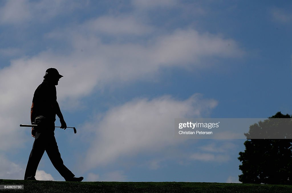 Phil Mickelson of the United States walks on the 16th hole during the continuation of the weather delayed first round of the U.S. Open at Oakmont Country Club on June 17, 2016 in Oakmont, Pennsylvania.