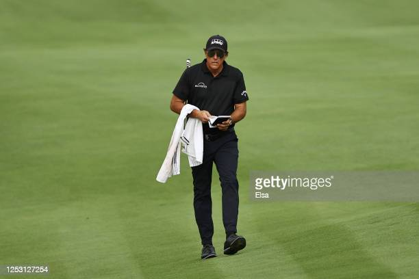 Phil Mickelson of the United States walks on the 18th hole during the final round of the Travelers Championship at TPC River Highlands on June 28...