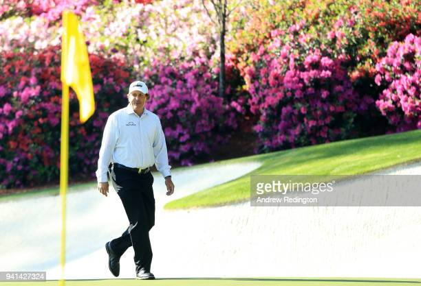 Phil Mickelson of the United States walks onto the 13th green during a practice round prior to the start of the 2018 Masters Tournament at Augusta...