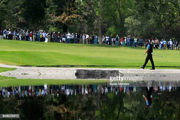 Phil Mickelson of the United States walks over the stone bridge on the sixth hole during the third round of the World Golf Championships Mexico...