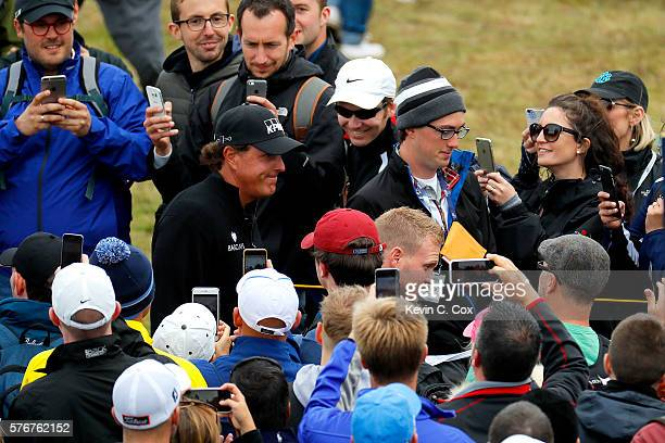 Phil Mickelson of the United States walks through the crowds on the way to on the 5th hole during the final round on day four of the 145th Open...