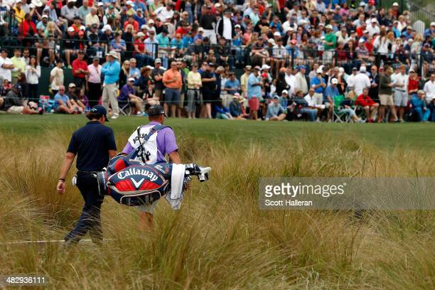 Phil Mickelson of the United States walks to the green of the sixteenth hole during round three of the Shell Houston Open at the Golf Club of Houston...