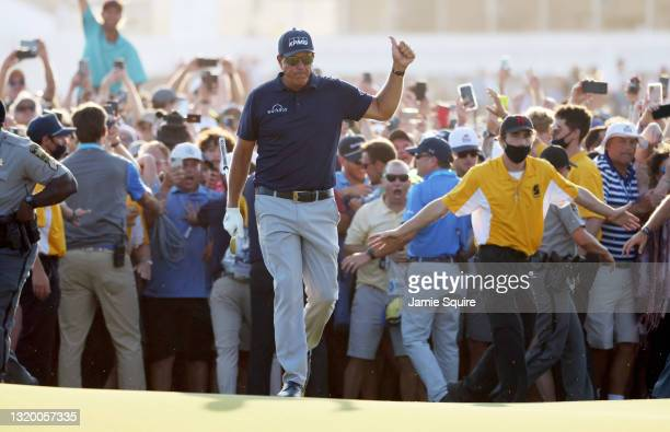 Phil Mickelson of the United States walks up the 18th fairway as fans cheer during the final round of the 2021 PGA Championship held at the Ocean...