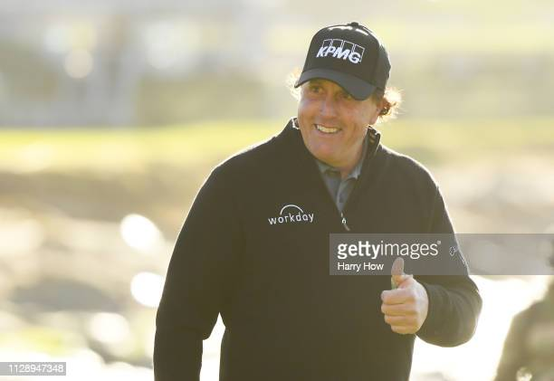 Phil Mickelson of the United States walks up the 18th hole during the continuation of the final round of the ATT Pebble Beach ProAm at Pebble Beach...