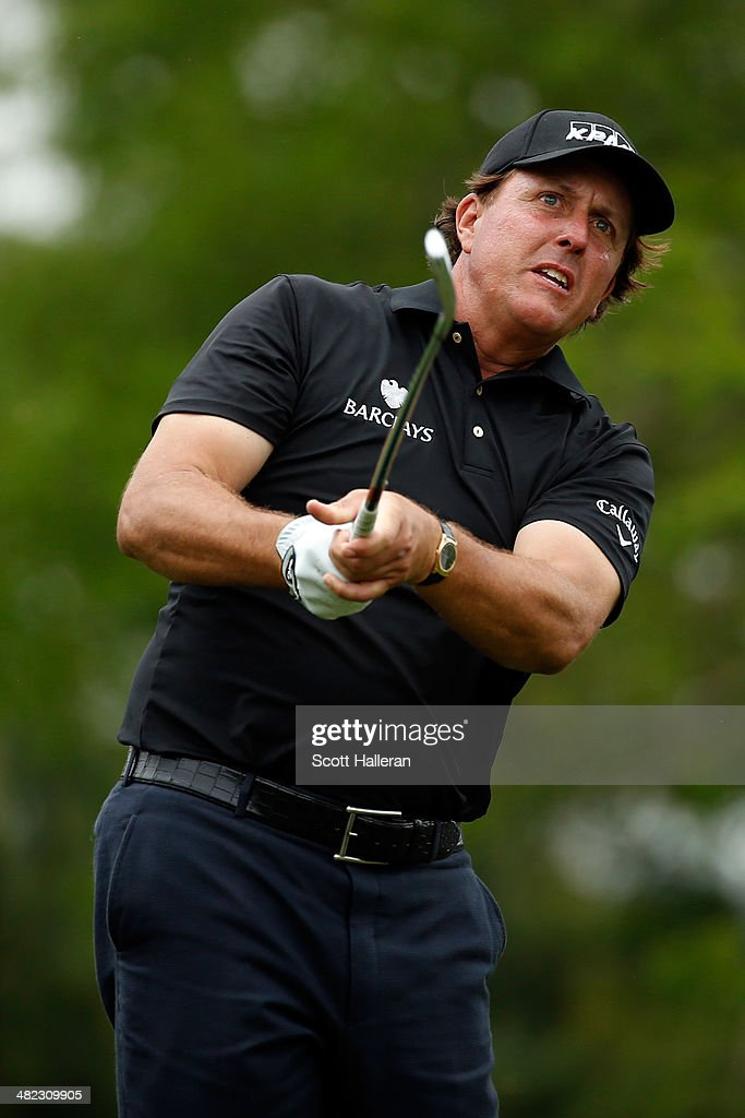 Phil Mickelson of the United States watches his tee shot on the ninth hole during round one of the Shell Houston Open at the Golf Club of Houston on April 3, 2014 in Humble, Texas.