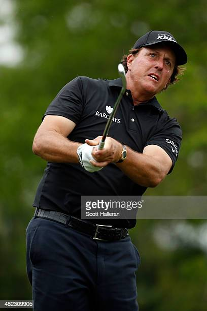 Phil Mickelson of the United States watches his tee shot on the ninth hole during round one of the Shell Houston Open at the Golf Club of Houston on...