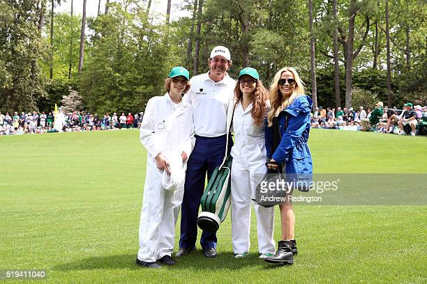 Phil Mickelson of the United States wife Amy son Evan and daughter during the Par 3 Contest prior to the start of the 2016 Masters Tournament at...