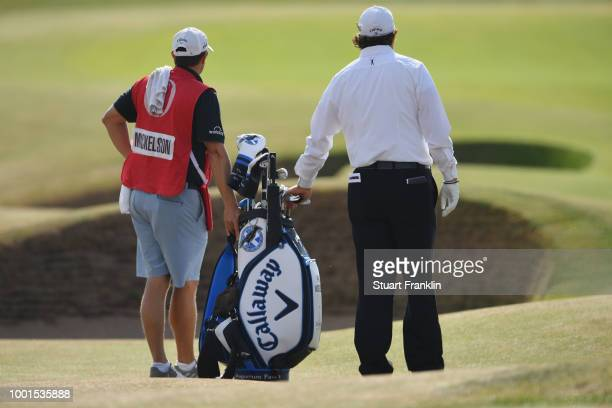 Phil Mickelson of the United States with his brother and caddie Tim Mickelson on the fifth fairway during the first round of the 147th Open...