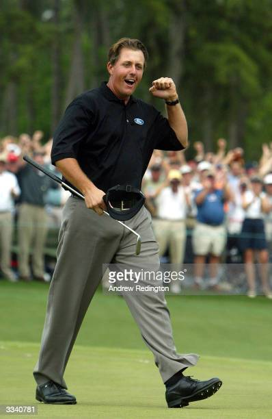 Phil Mickelson of the U.S. Celebrates after his birdie to win the Masters by one shot on the 18th green during the final round of the Masters on...