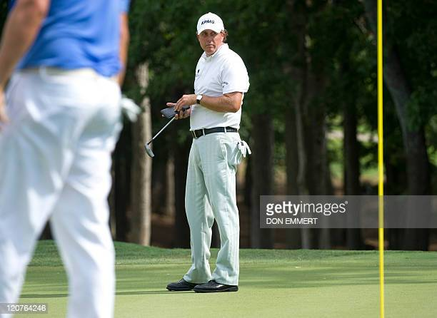Phil Mickelson of the US on the 10th green during a practice round of the 2011 PGA Championship Tournament at Atlanta Athletic Club August 9 2011 in...