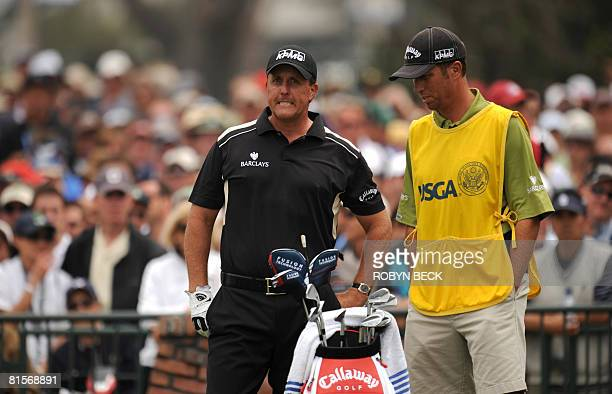 Phil Mickelson of the US prepares to hit on the first tee the third round of the 108th US Open golf tournament at Torrey Pines Golf Course in San...