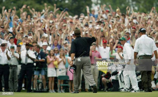 Phil Mickelson of the US pumps his fist after his birdie putt on the 18th hole to win the Masters Golf Tournament at Augusta National Golf Club 11...