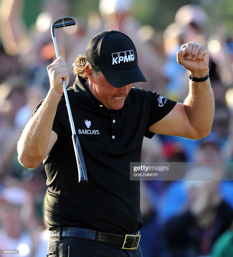 Phil Mickelson of the US reacts after sinking his putt on the 18 hole to win the 2010 Masters Tournament at Augusta National Golf Club on April11, 2010 in Augusta, Georgia. The 39-year-old left-hander finished 72 holes on 16-under par 272 .
