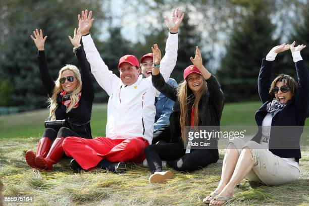 Phil Mickelson of the US Team and his family wife Amy son Evan and daughter Sophia wave on the eighth hole during Saturday fourball matches of the...