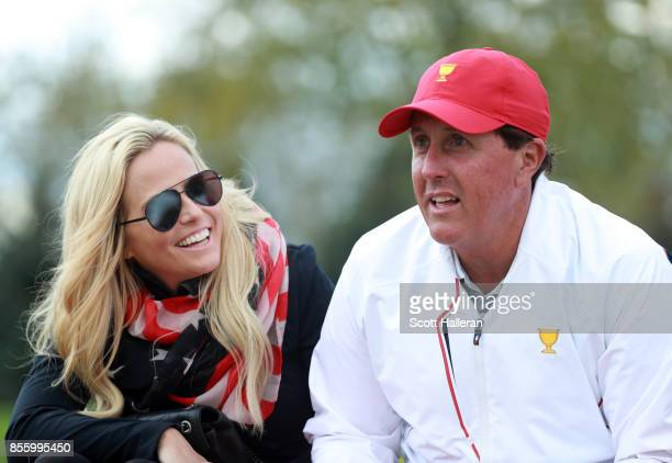 Phil Mickelson of the US Team and wife Amy Mickelson during the afternoon fourball matches at the Presidents Cup at Liberty National Golf Club on...