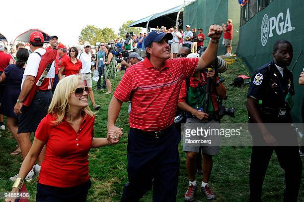 Phil Mickelson of the US team center and his wife Amy react after the US team's victory on day three of the 37th Ryder Cup at Valhalla Golf Club in...