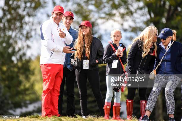 Phil Mickelson of the US Team gives a thumbs up to fans while standing with wife Amy and their family during Saturday afternoon FourBall matches in...