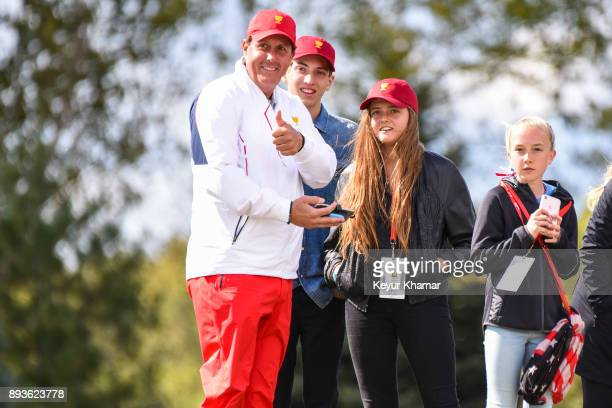 Phil Mickelson of the US Team gives a thumbs up to fans while standing with his family during Saturday afternoon FourBall matches in the third round...