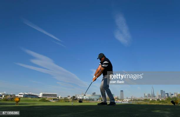 Phil Mickelson of the US Team plays his shot from the 14th tee during the first round of the Presidents Cup at Liberty National Golf Club on...