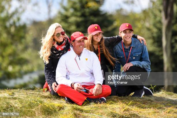 Phil Mickelson of the US Team poses with his wife Amy and their children during Saturday afternoon FourBall matches in the third round of the...