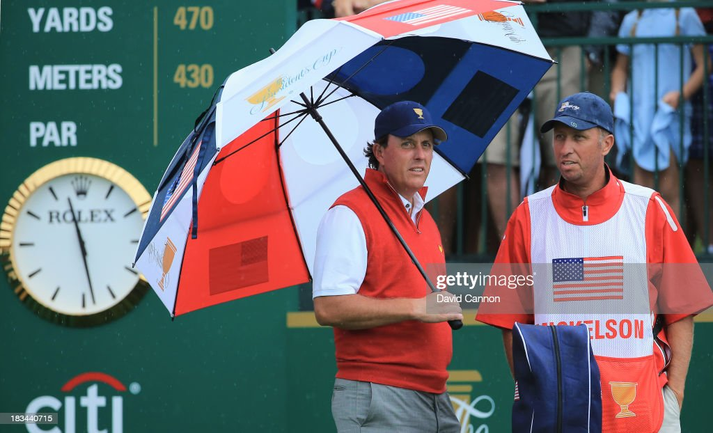 Phil Mickelson of the U.S. Team waits with his caddie Jim Mackay on the first tee during the Day Four Singles Matches at the Muirfield Village Golf Club on October 6, 2013 in Dublin, Ohio.