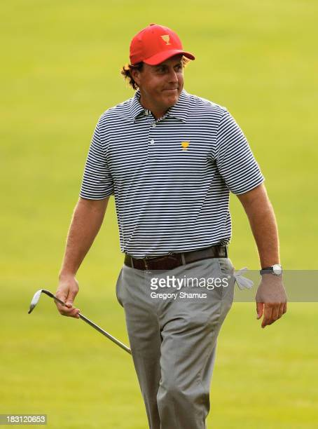 Phil Mickelson of the U.S. Team walks to a green during the Day Two Foursome Matches at the Muirfield Village Golf Club on October 4, 2013 in Dublin,...