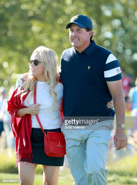 Phil Mickelson of the US Team walks with his wife Amy during the Thursday foursomes matches of the first round of the Presidents Cup at Liberty...