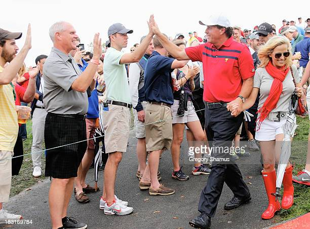 Phil Mickelson of the US Team walks with his wife Amy walk off the 17th hole after the team of Mickelson/Bradley defeated the Els/de Jonge team 21...
