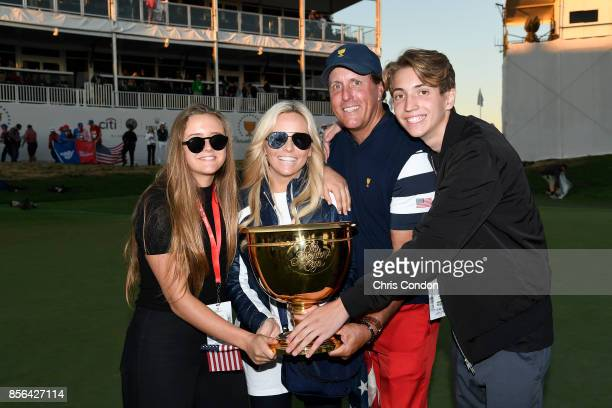 Phil Mickelson of the US Team wife Amy Mickelson son Evan and daughter Sophia celebrate with the trophy after the US Team defeated the International...