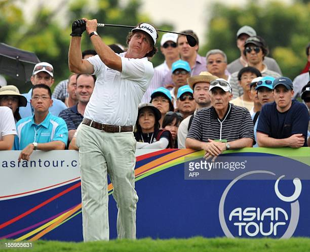 Phil Mickelson of the US tees off during day three of the Barclays Singapore Open Golf tournament at the Sentosa Golf Club in Singapore on November...