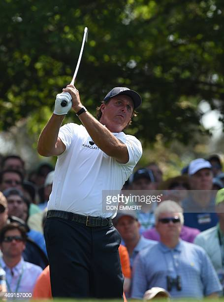 Phil Mickelson of the US watches his tee shot on the 4th hole during Round 1 of the 79th Masters Golf Tournament at Augusta National Golf Club on...