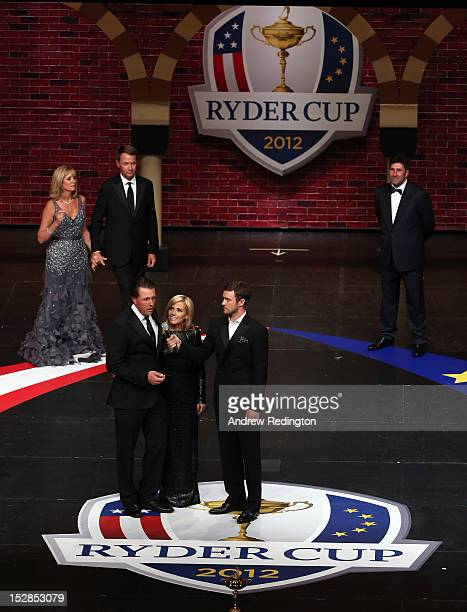 Phil Mickelson of the USA and his wife Amy Mickelson talk with Justin Timberlake at the 39th Ryder Cup Gala at Akoo Theatre at Rosemont on September...