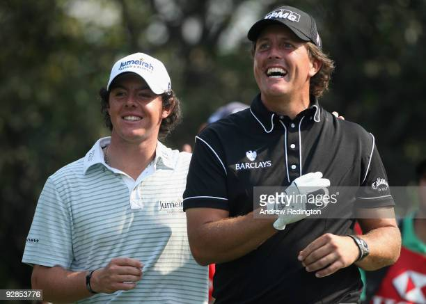 Phil Mickelson of the USA and Rory McIlroy of Northern Ireland share a joke on the fifth hole during the second round of the WGC-HSBC Champions at...