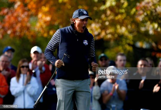 Phil Mickelson of the USA celebrates winning the ninth hole during day two of the Morning Foursome Matches for The 39th Ryder Cup at Medinah Country...