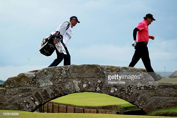 Phil Mickelson of the USA crosses the Swilken Bridge with his caddie Jim Mackay during the first round of the 139th Open Championship on the Old...