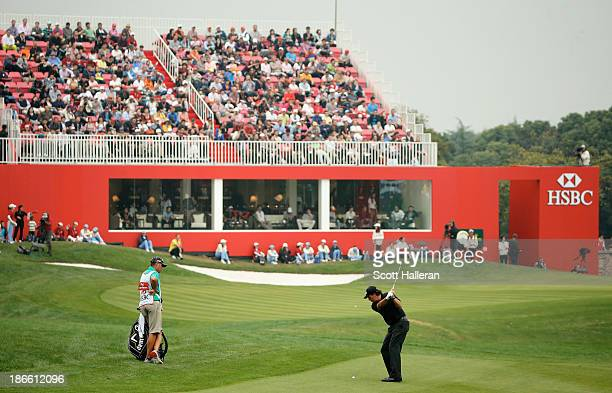 Phil Mickelson of the USA hits a shot on the 18th hole during the third round of the WGC-HSBC Champions at the Sheshan International Golf Club on...