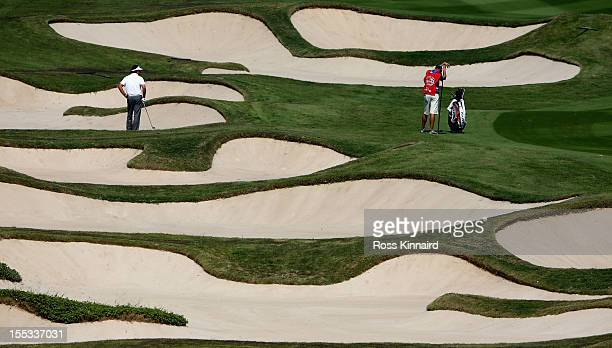 Phil Mickelson of the USA in the bunkers on the 10th hole during the third round of the WGC HSBC Champions at the Mission Hills Resort on November 3...