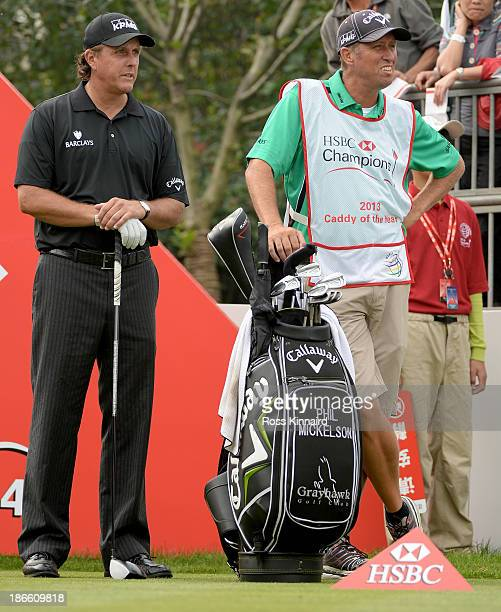 Phil Mickelson of the USA on the first tee beside Jim ''Bones'' MacKay who wears the HSBC Caddy of the Year bib during the third round of the WGC...