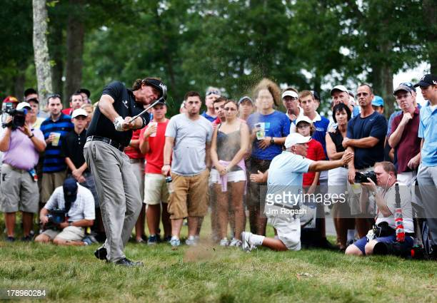 Phil Mickelson of the USA plays a shot from the rough on the 13th hole during the second round of the Deutsche Bank Championship at TPC Boston on...
