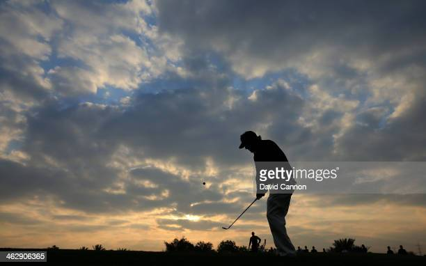 Phil Mickelson of the USA plays his fourth shot at the par 5, 10th hole during the first round of the 2014 Abu Dhabi HSBC Golf Championship at Abu...