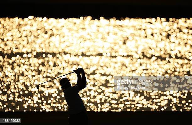 Phil Mickelson of the USA plays his second shot on the 18th hole during round one of THE PLAYERS Championship at THE PLAYERS Stadium course at TPC...