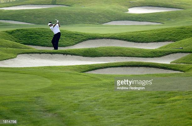 Phil Mickelson of the USA plays his second shot on the eighth hole during the first round of the World Golf Championships American Express...